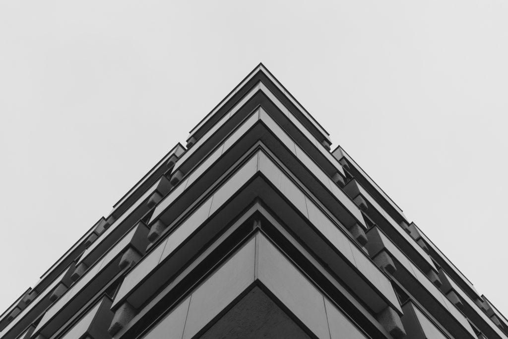 low angle shot of a grey concrete building representing modern architecture